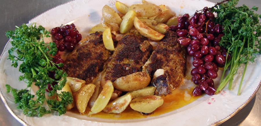 Vis in kruidenkorst, gegrilde druiven & ovenaardappeltjes